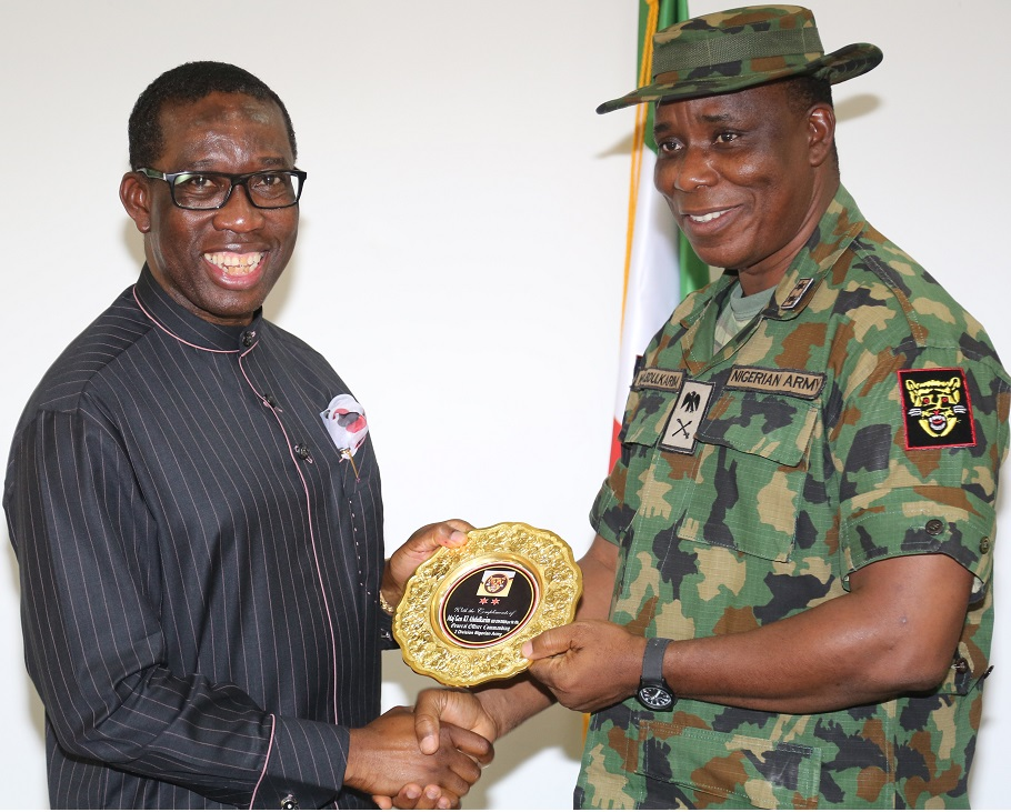Delta State Governor, Senator Ifeanyi Okowa (left), receiving a survenir from the General Officer in Command (GOC) 2 Division, Major General Kashimu Abdul'Karim during a courtesy call by the General on Governor Ifeanyi Okowa in Asaba.
