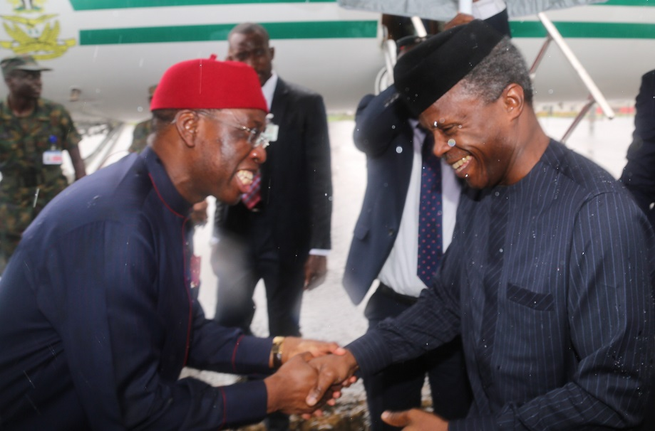 Delta State Governor, Senator Ifeanyi Okowa (left), welcoming the Vice President, Federal Republic of Nigeria, Prof. Yemi Osimbajo at the Asaba International Airport  to attend the State Economic Summit to mark its 25th Anniversary in Asaba.